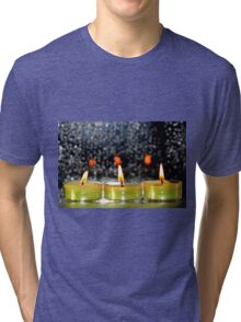 A row of candles Tri-blend T-Shirt