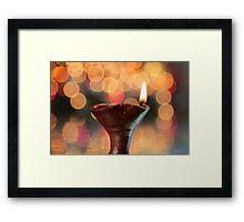 A lit lamp Framed Print