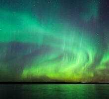 Northern lights over lake in finland by Juhani Viitanen
