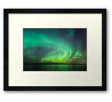 Northern lights over lake in Finland Framed Print