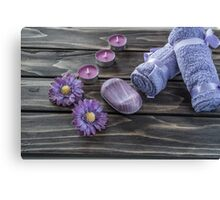 Spa concept. flowers,candles and bath purple towels Canvas Print