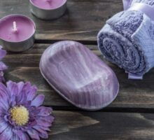 Spa concept. flowers,candles and bath purple towels Sticker