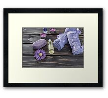 Spa concept. Lavender oil, flowers bath  and purple towels Framed Print