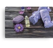 Spa concept. Lavender oil, flowers bath  and purple towels Canvas Print