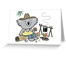 Cartoon koala bear sitting by campfire in outback Greeting Card
