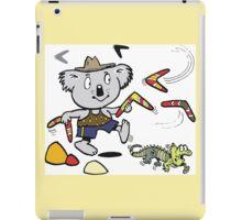 Cartoon koala bear throwing boomerangs at lizard iPad Case/Skin