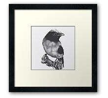 Bird on a tree branch Framed Print