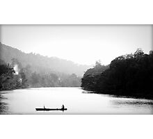 One Man in his Boat Photographic Print