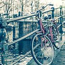 Amsterdam canal and bicycles by gianliguori