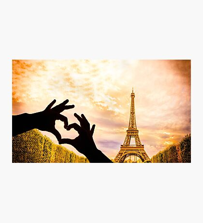 The Eiffel Tower in Paris and hands in a heart shape Photographic Print