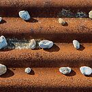 Pebbles on Rust by Dave Hare
