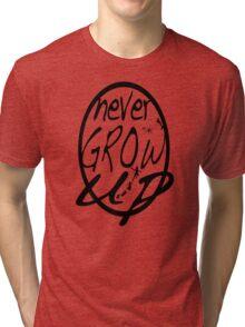 Never grow up. Tri-blend T-Shirt