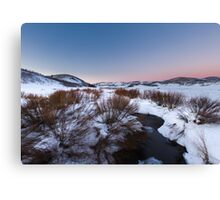 River Flowing in snow field sunset Canvas Print