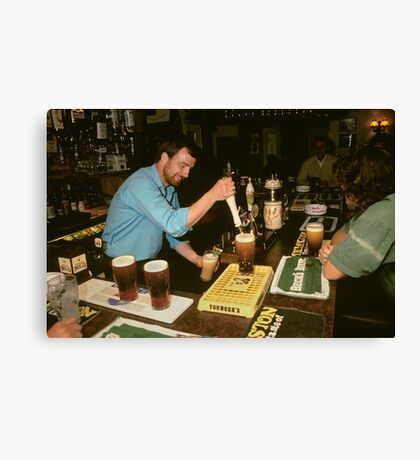 Landlord serving pints of beer, UK, 1980s. Canvas Print