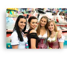 4 gorgeous young women at German funfair Canvas Print