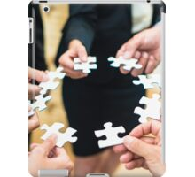 Teamwork - a group of eight business people assembling a jigsaw puzzle - representing team support and help concepts iPad Case/Skin