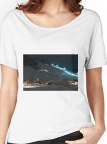 Ski village at night with slope lights, cross-country ski run, buildings, ice monument - shot in Livigno, Italian Alps Women's Relaxed Fit T-Shirt