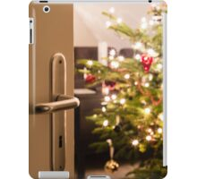Interior shot of a modern living room with a Christmas tree as seen through the living room door iPad Case/Skin