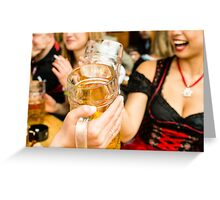 Bavarian girls in traditional Dirndl dresses are drinking beer and having fun at the Oktoberfest Greeting Card