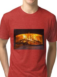 traditional Italian pizza wood oven with raw pizza and large fire in the background Tri-blend T-Shirt