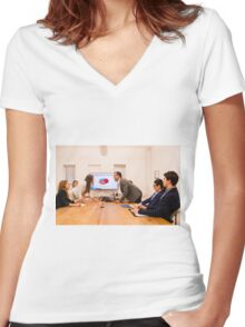 Conflict in the office : Business woman arguing with her boss at meeting over latest sales figures with others watching embarassed Women's Fitted V-Neck T-Shirt