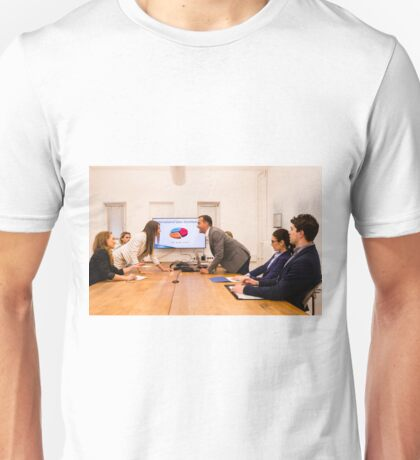 Conflict in the office : Business woman arguing with her boss at meeting over latest sales figures with others watching embarassed Unisex T-Shirt