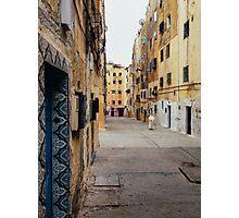 Old Woman Walking Through Poor Neighbourhood Photographic Print