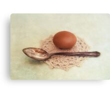 Egg and spoon Canvas Print