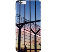 View through a barbed wire fence with beautiful colourful sunset sky in Dieppe France iPhone Case/Skin