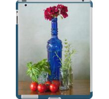 Blue glass bottle with vegetables and flowers iPad Case/Skin