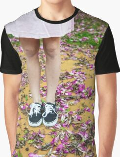 young girl in a park with purple flowers on floor Graphic T-Shirt