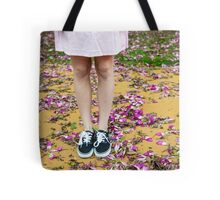 young girl in a park with purple flowers on floor Tote Bag