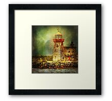 Lighthouse with stormy weather Framed Print
