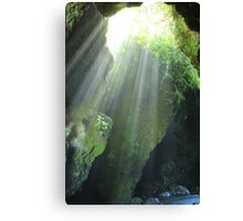 Sunlight Streaming Into a Cave Canvas Print
