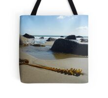 Seaweed with rocks, sand and sea at Porth Ysgo Tote Bag