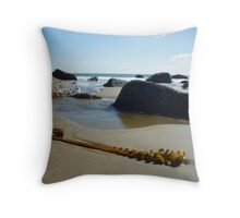 Seaweed with rocks, sand and sea at Porth Ysgo Throw Pillow