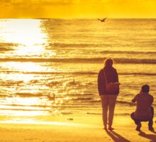 Sunset on beach in Domburg with couple taking pictures Sticker