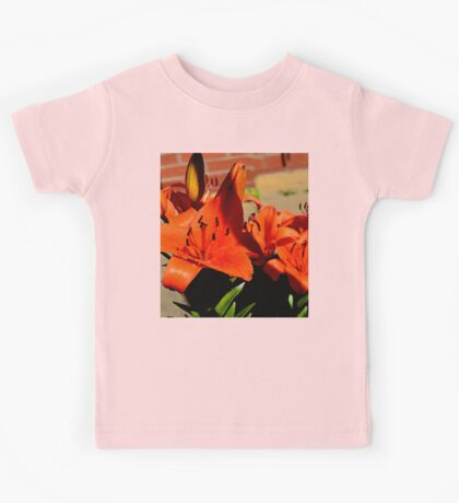 the colourful flowers that stand out  Kids Tee