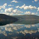 Clouds above and in lake Svenningsvatnet by Arie Koene