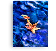 Autumn leaves floating on dark blue water of Blue Spring State Park in Florida Canvas Print