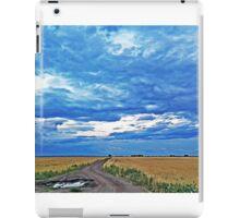 Rural road in a wheat field under a stormy sky iPad Case/Skin
