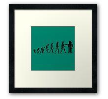 EVOLUTION SUCKS Framed Print