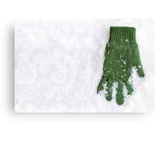 Glove Laying in Snow Canvas Print
