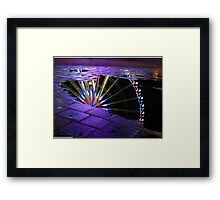 Big Wheel reflected in water Framed Print