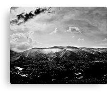 Valley under clouds Canvas Print