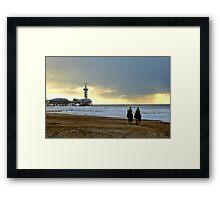 Riding on a stormy beach Framed Print
