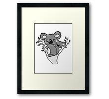 sweet little cute koala mamapapa child baby family climbs on tree eucalyptus tree Framed Print