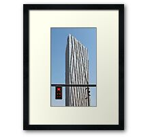 red traffic light in the city Framed Print