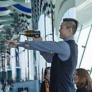 United Arab Emirates. Dubai. Burj Al Arab. Skyview Bar. How to Pour a Glass of Champagne. by vadim19