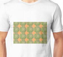 Limes on orange background color photo Unisex T-Shirt